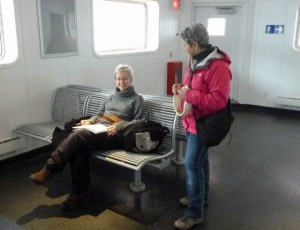 Claudette, talking with one of the passengers