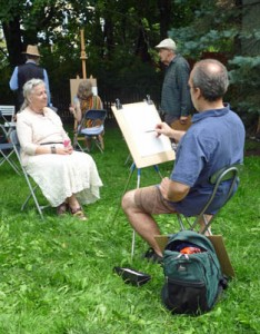 Richard is drawing a lovely lady who volunteered to pose for him.
