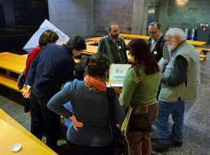 A group admiring Jacques Paquet's sketch box