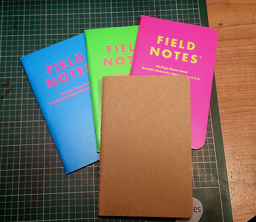 THree Field Notes notebooks and a Moleskine Cahier.  Either works well if you avoid fountain pens.